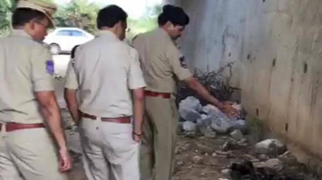 In this frame grab taken from video provided by KK Productions, Indian police officers inspect the site where they found the burned body of a 27-year-old veterinary doctor who they say was raped and killed on the outskirts of Hyderabad.(AP)