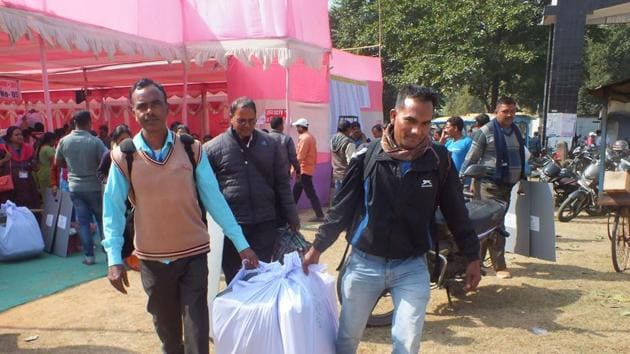 Latehar: Officials carry election material as they leave for their polling stations ahead of the Jharkhand Assembly elections, in Latehar district, Friday, Nov. 29, 2019. (PTI Photo)(PTI11_29_2019_000053A)(PTI)