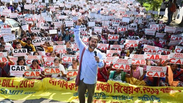 Krishak Mukti Sangram Samiti (KMSS) advisor Akhil Gogoi with supporters raise slogans during a protest against the Citizenship (Amendment) Bill, in Guwahati.(PTI)