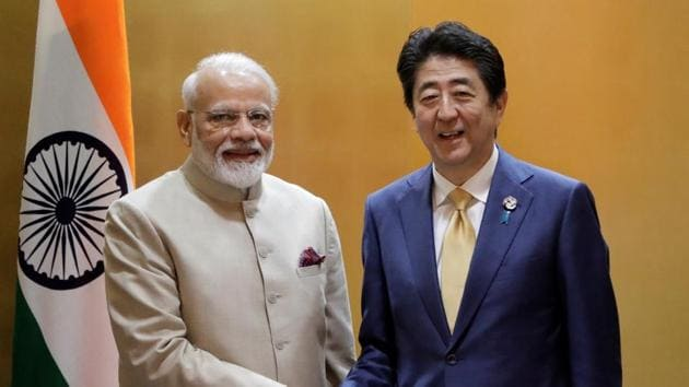Narendra Modi, India's prime minister, shakes hands with Shinzo Abe, Japan's prime minister, during a bilateral meeting ahead of the Group of 20 (G-20) summit in Osaka, Japan.(REUTERS)