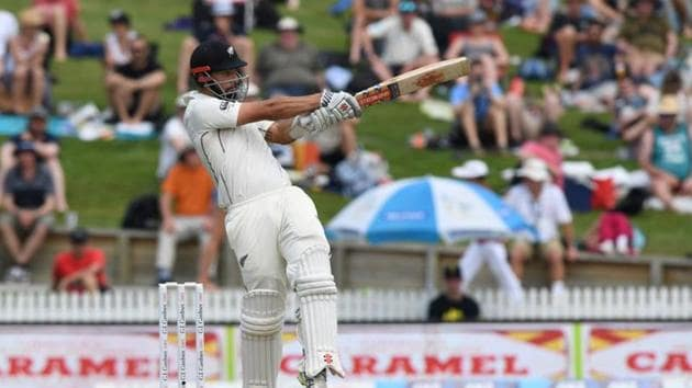 New Zealand's Daryl Mitchell hits a boundary.(REUTERS)