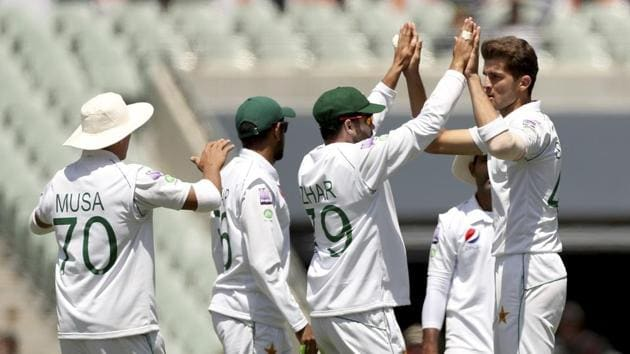 Pakistan fielders celebrate the fall of a wicket during Day-Night Test in Adelaide.(AP)