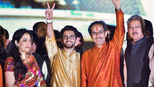 Newly sworn-in Chief Minister of Maharashtra Uddhav Thackeray, his son and Yuva Sena Chief Aaditya Thackeray acknowledge their supporters, at Shivaji Park in Mumbai.(Photo: PTI)