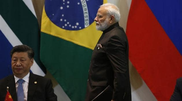 India's Prime Minister Narendra Modi walks past China's President Xi Jinping at the Leaders Dialogue with BRICS Business Council and the New Development Bank at the Itamaraty Palace in Brasilia, Brazil on November 14, 2019.(AP)