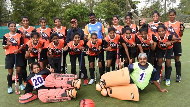 Pune team poses after winning the first senior women's hockey championship thrashing Nashik at Shiv Chhatrapati sports complex in Pune on Saturday. Home side used two goalkeepers in the final.(HT/PHOTO)