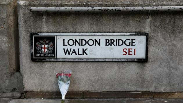 Flowers are laid down for the victims at the scene of a stabbing on London Bridge, in which two people were killed, in London, Britain, November 30, 2019.(REUTERS)