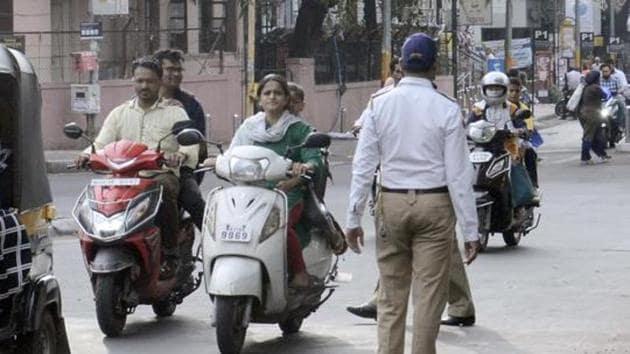 Pune traffic police not taking action against helmet-less riders on Tilak road.(HT FILE PHOTO)