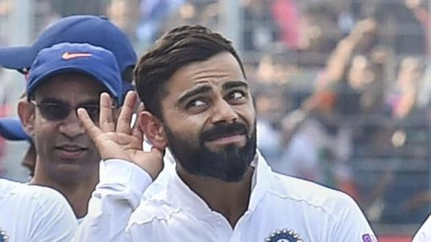 Indian team captain Virat Kohli gestures as he walks with his teammates after winning the day-night Test series against Bangladesh, at Eden Gardens in Kolkata, Sunday, Nov. 24, 2019.(PTI)