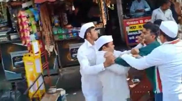 Bisht seen in a scuffle with Nainital Congress leaders during a protest against high prices of onions.(Sourced Picture)