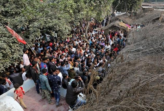 People gather outside the house of the 24-year-old rape victim, who died in a New Delhi hospital on Friday after she was set on fire by a gang of men, which included her alleged rapists, in Uttar Pradesh's Unnao.(REUTERS Photo)