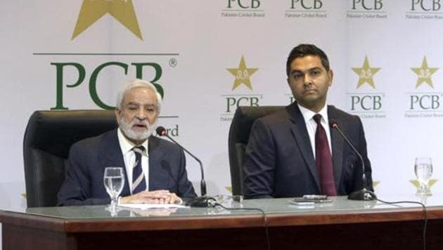 Pakistan Cricket Board's new managing director Wasim Khan, right, looks on during a press conference with the PCB chairman Ehsan Mani in Lahore, Pakistan.(AP)