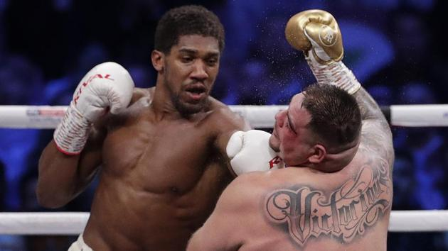 Defending champion Andy Ruiz Jr., right, takes a left jab during his fight against Britain's Anthony Joshua in their World Heavyweight Championship contest at the Diriyah Arena, Riyadh.(AP)