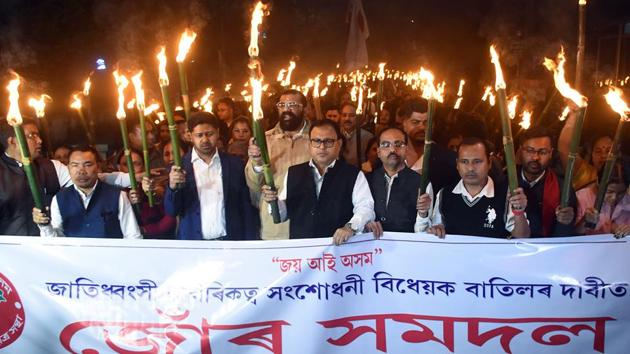 Activists of the All Assam Students Union (AASU) take part in a torchlight protest rally against the 'Citizenship (Amendment) Bill, in Guwahati.(ANI Photo)