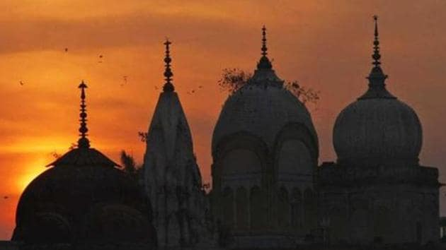 Birds fly at sunset over a Hindu temple in Ayodhya. (AP Photo)