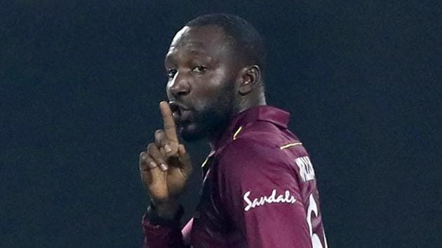 West Indies' Kesrick Williams gestures to his teammate to celebrate the dismissal of India's captain Virat Kohli.(AP)