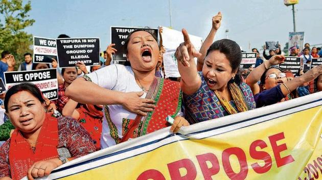 People shout slogans, as they protest against the Citizenship Amendment Bill (CAB), during the shutdown called by North East Students' Organization (NESO), in Agartala on Tuesday.(Photo: ANI)