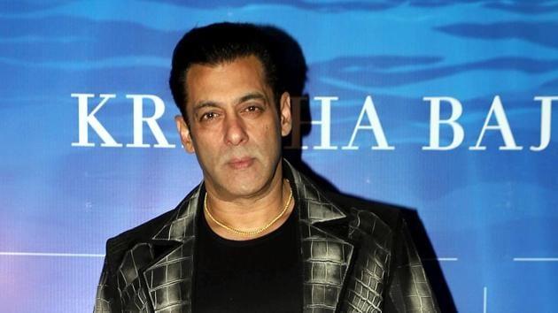 Salman Khan poses for pictures at designer Kresha Bajaj's fashion show in Mumbai on Sunday. (ANI Photo)(ANI)