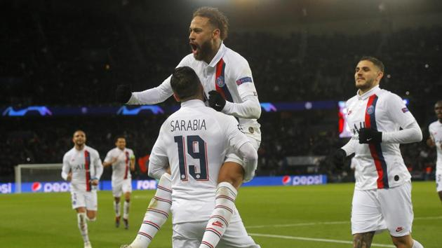 PSG's Pablo Sarabia, left, celebrates after scoring his side's second goal with his teammates Neymar, and Mauro Icardi, right, during the Champions League.(AP)