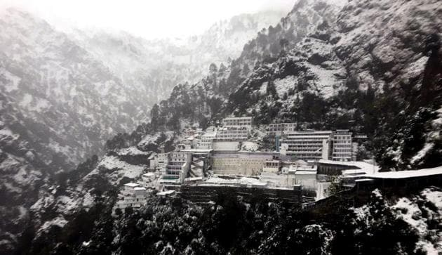 A view of the Vaishno Devi shrine in Trikuta Hills of the Jammu region that received the season's first snowfall on Friday.(HT Photo)