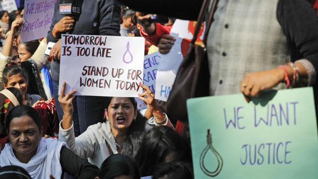 Women activists hold banners and shout slogans demanding justice in the case of a veterinarian who was gang-raped and killed in Telangana.(AP FILE PHOTO.)