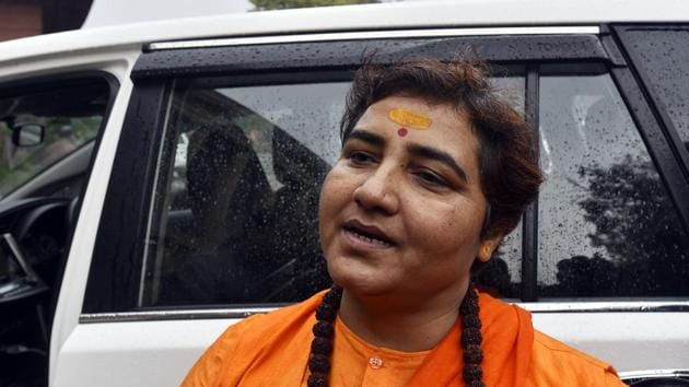 BJP MP Pragya Singh Thakur arrives to pay floral tributes to martyrs who sacrificed their lives during the 2001 terrorist attack on the Parliament in New Delhi on Friday.(Sanjeev Verma/HT PHOTO)