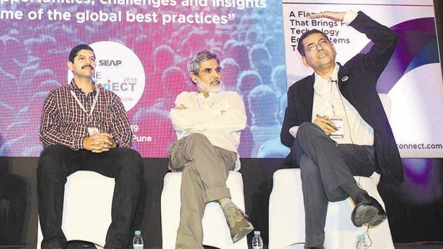 (From left to right) Aditya Abhyankar, Parag Kulkarni and Milind Pande during the inaugural ceremony of the 8th edition 'Pune Connect 2019', at Hyatt Regency on Saturday.(Shankar Narayan/HT PHOTO)