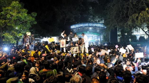 Students from Jawaharlal Nehru University (JNU) hold portraits of Mahatma Gandhi and BR Ambedkar and raise slogans to protest against the Delhi Police action on the students of Jamia Millia Islamia (JMI), and in solidarity with the students of JMI, outside Police Headquarters (PHQ), in New Delhi, India, on Sunday, December 15, 2019. (Photo by Amal KS / HT Photo)