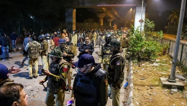Policemen stand guard near Jamia Millia Islamia following the protests against Citizenship Amendment Act, in New Delhi, Sunday, Dec. 15, 2019.(PTI)