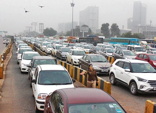 Long queues of vehicles are seen at the Kherki-Daula toll plaza on the second day of FASTag toll being implemented, in Gurugram, India, on Monday, December 16, 2019. More than two kilometres of traffic jam was seen at the toll plaza.(Yogendra Kumar / HT Photo)