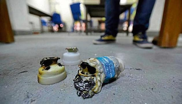 A spent tear gas shell is seen on the floor of Zakir Husain Library after police entered the university campus later on Sunday evening and beat the students, at Jamia Millia Islamia, in New Delhi, India, on Monday, December 16, 2019.(Burhaan Kinu/HT Photo)
