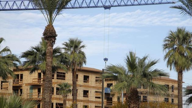 In this Wednesday, Dec. 4, 2019, photo is one of the many new apartment complexes being build in the downtown area in Phoenix. Phoenix has some of the nation's fastest-rising rents as people abandon the cold winters in the Midwest or flee high housing costs in California.(AP)