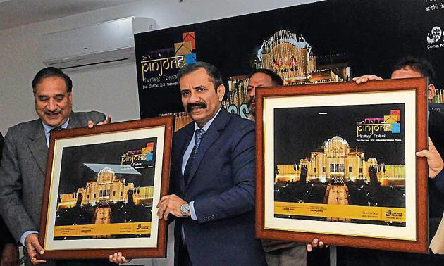 (From left) Haryana Tourism Corporation managing director Vikas Yadav and additional chief secretary, Haryana tourism department, Vijai Vardhan launching the poster of the 12th Pinjore Heritage Festival at Haryana Niwas in Sector 3, Chandigarh, on Wednesday.(HT PHOTO)