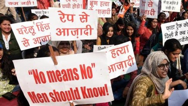 Supporters hold placards demanding capital punishment for the all rape-murder convicts.(Sonu Mehta/HT Photo)