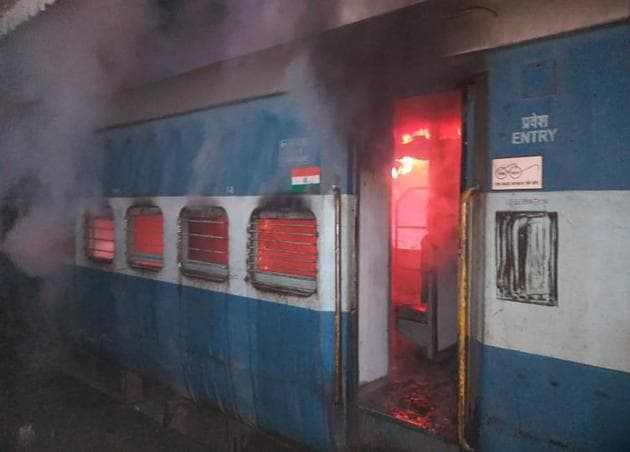 One of the three compartments of Shaheed Express, a passenger train headed for Amritsar, that caught fire near Kartarpur in Jalandhar district on Wednesday night.(Pardeep Pandit/HT)