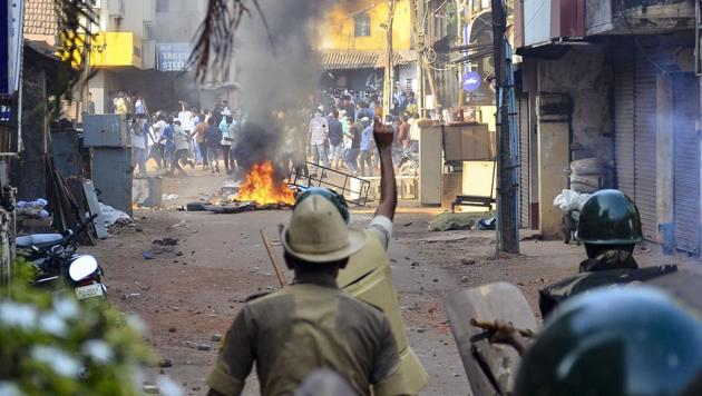 Mangaluru: Police personnel during their clash with the protestors participating in a rally against the amended Citizenship Act and NRC, in Mangaluru on Thursday.(PTI Photo)