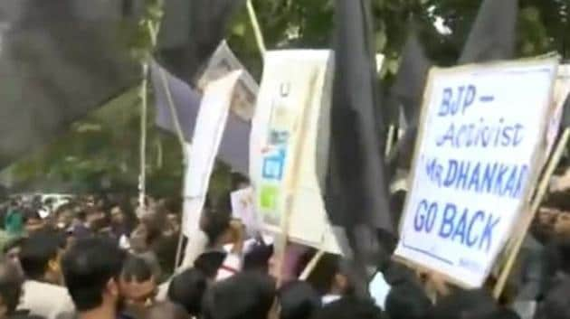 Jadavpur University students waving black flags against Bengal governor Jagdeep Dhankhar.