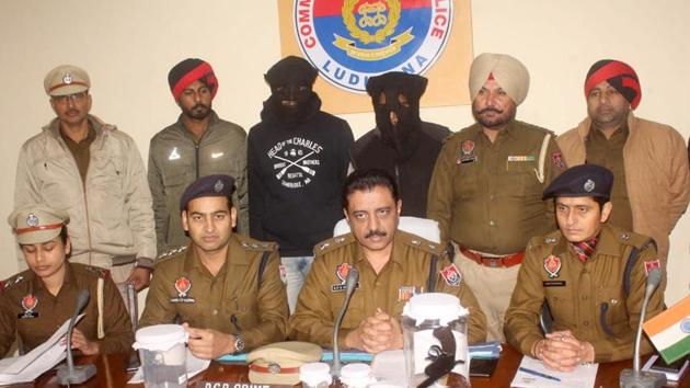 The accused (masked) in police custody in Ludhiana on Monday.(HT PHOTO)