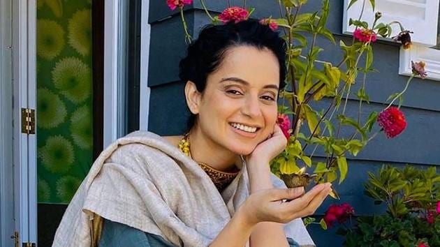 Kangana Ranaut poses for a photo as she celebrates Diwali at her new residence 'Kartik Niwas' in Manali.(PTI)