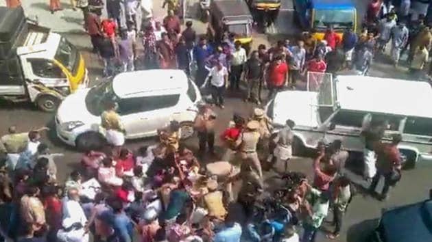 Kannur: Police detain DYFI activists who blocked Karnataka Chief minister BS Yediyurappa's vehicle during a protest in Kannur(PTI Photo)