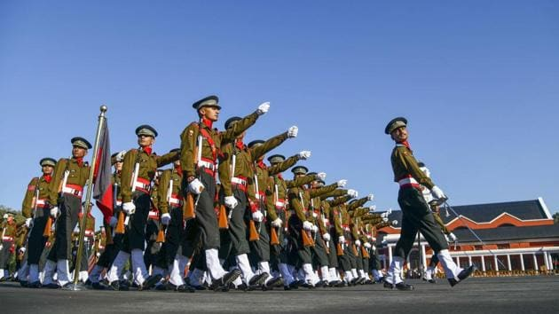 Newly commissioned army officers march during the 142nd passing out parade at Indian Military Academy (IMA), in Dehradun, on December 7.(PTI Photo)