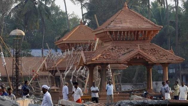 People look at the damaged structure after a massive fire broke out during a fireworks display at the Puttingal temple complex in Paravoor village, Kollam district in 2016.(PTI/ File Photo)