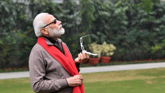 PM Modi posted picture of himself trying to watch the solar eclipse.(Twitter/@narendramodi)