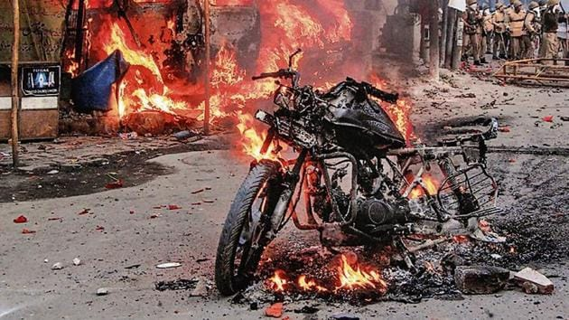 A vehicle torched allegedly by protestors during a demonstration against the Citizenship Amendment Act.(PTI Photo)