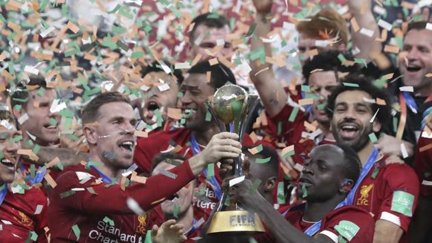 Doha: Players of Liverpool celebrate after winning the Club World Cup final.(AP)