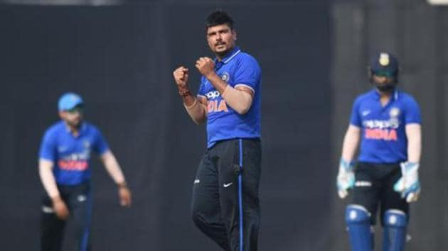 India A bowler Karn Sharma (C) celebrates after taking the wicket of New Zealand captain Kane Williamson.(AFP)