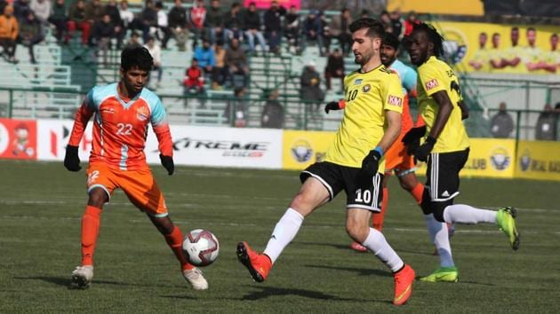 Players from the Real Kashmir and Chennai City football clubs seen in action.(HT Photo)