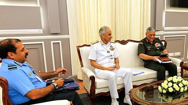 Army Chief General Bipin Rawat, Navy Chief Admiral Karambir Singh, and IAF Chief Air Chief Marshal RKS Bhadauria in a discussion.(ANI Photo)