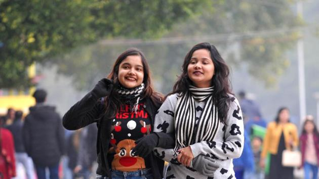 Girls taking a stroll at Sukhna Lake in Chandigarh on Thursday. The IMD has predicted dense to very dense fog with visibility as low as 50 metres on isolated stretches of city roads(RAVI KUMAR/HT)
