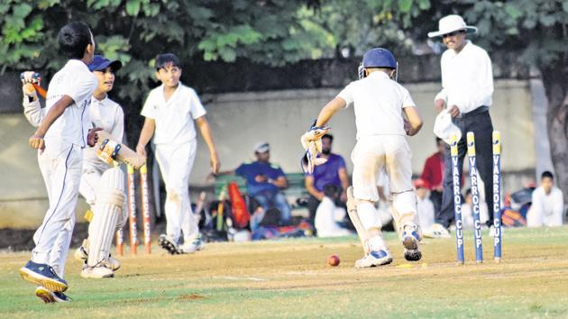 Virag Academy's Jaywardhan Dedge run out at Varroc cricket academy ground Thergaon in Pune on Thursday.(HT PHOTO)