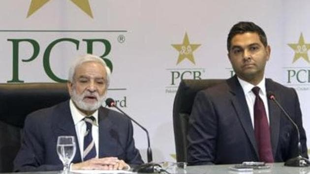 Pakistan Cricket Board's new managing director Wasim Khan, right, looks on during a press conference with the PCB Chairman Ehsan Mani in Lahore.(AP)